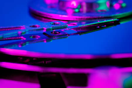 Inside of hard disk drive, macro view. Different light sources (colors). Shallow DOF