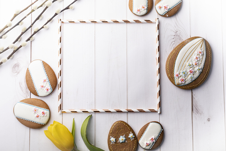 Easter cookies and spring decorations on a wooden background Stock Photo