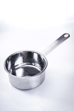 Stainless steel pot, kitchen equipment on a white background.