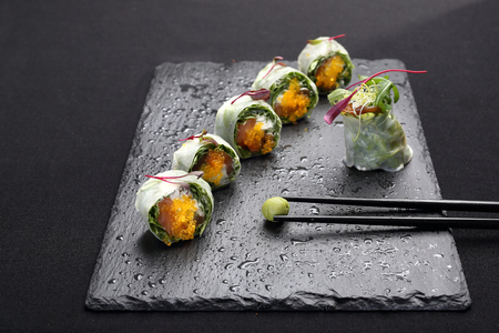 Set of sushi on a black stone