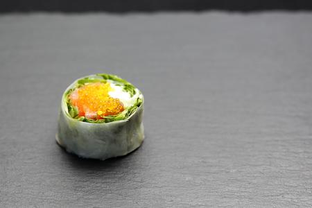 Set of sushi on a black stone Imagens - 121469241