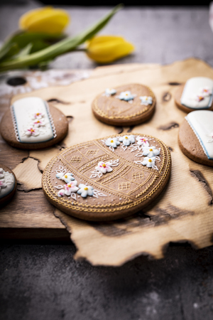 Easter cookies and spring decorations on a wooden background