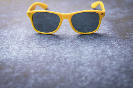 A composition of sunglasses frames on a dark background, with space for text. Reklamní fotografie