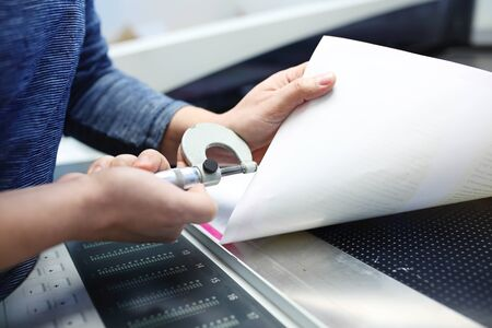 Printer at work. The printer measures the weight of the paper.