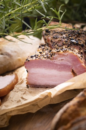 Home-made appetizing meat in a composition with herbs on an ecological rural natural background. Banco de Imagens
