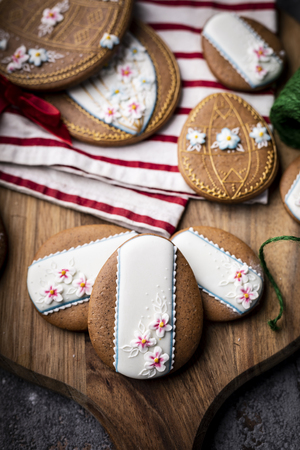 Easter cookies and spring decorations on a wooden background 写真素材