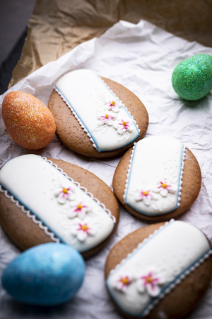 Easter cookies and Christmas decorations on a wooden background