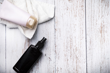 Sunscreen cosmetics. A bottle of sunscreen and protective cream on a wooden background.