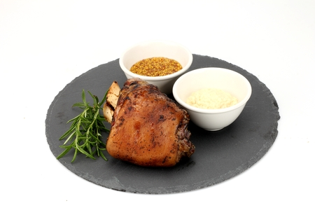 Roasted pork knuckle served with mustard and mayonnaise sauce