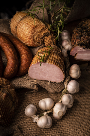 Natural traditional smoked, homely sausage in composition with fresh garlic and herbs