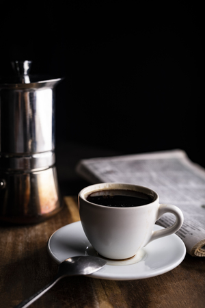 Coffee and newspaper. Relax with a cup of aromatic coffee.