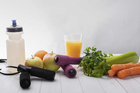 Healthy vegetable and fruit diet and gymnastic exercises. Composition with space for text