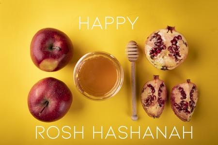 A composition of traditional symbolism on the occasion of the Jewish holiday of Rosh Hashanah Stock Photo