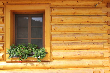 Window in a wooden house, background. Stock fotó