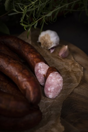 A bunch of dry, smoked sausage on an ecological rural natural background. 版權商用圖片