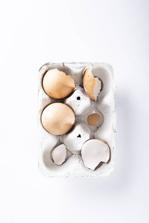A composition of hen eggs on a dark background. Top view composition Фото со стока