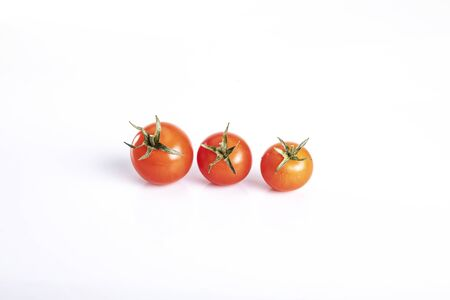 Product on a white background. ripe, red tomatoes Фото со стока