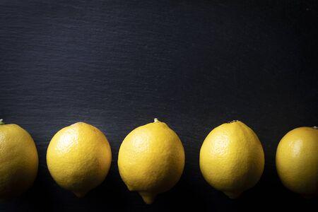 Composition of lemons on a black background
