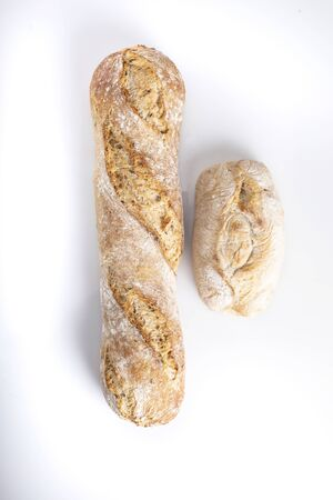 Bread on a white background, fresh bread made from wheat flour. top view