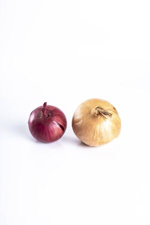 Product on a white background. Red and yellow  onions