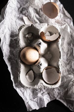 A composition of chicken eggs on a dark background. Top view composition Фото со стока