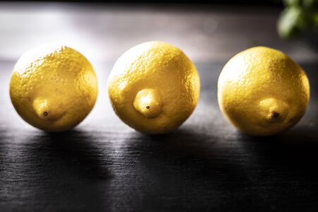 Composition of three lemons on a black background
