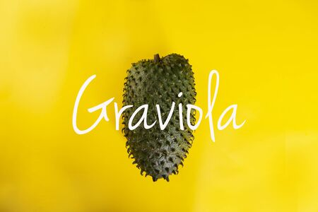 Ripe tropical fruit on a yellow background.