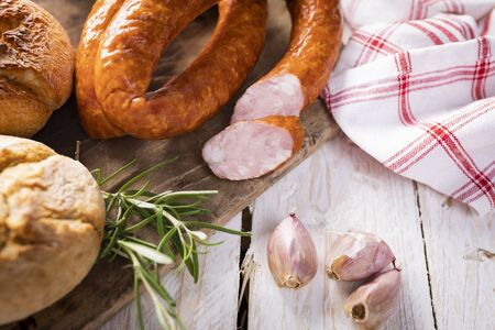 A thin traditional pork sausage in composition with fresh herbs
