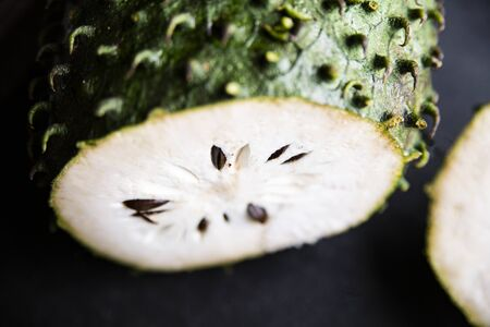 Ripe tropical fruit on a black background.