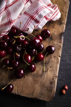 Composition of ripe cherry fruit on a wooden board 写真素材