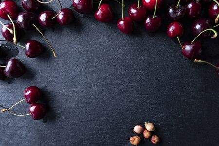 Composition of ripe cherry fruit on a dark background, top view 写真素材