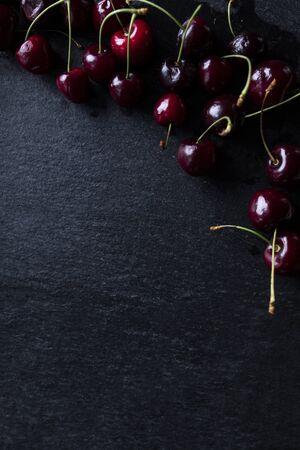 Juicy cherries. Cherries on a black background.