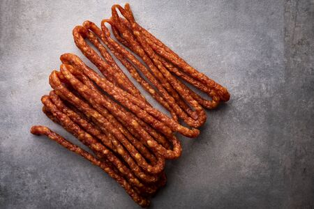 Smoked sausage, a composition of traditional dry, thin rural meats Regional food. 写真素材