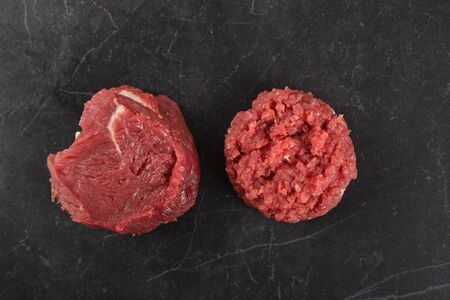 Raw, fresh meat on a black background.