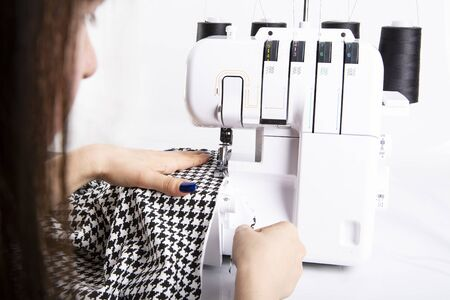 Overlock sewing. Sewing clothes on a sewing machine. Womans upholstery 스톡 콘텐츠