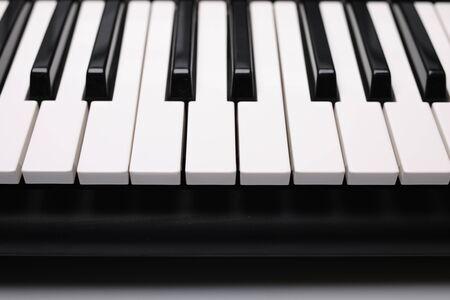 Instruments keys, black and white buttons. Reklamní fotografie
