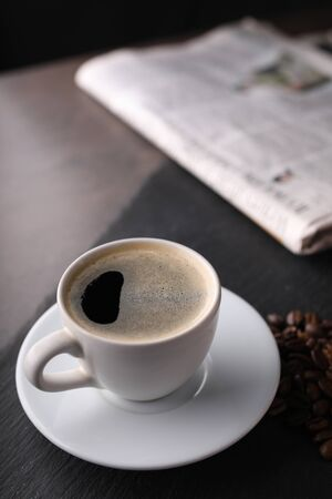 A cup of aromatic black coffee on a  black table. Top viev Imagens