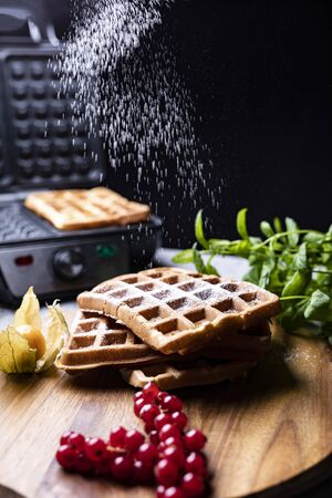 Classic golden Belgium waffles sifted with powdered sugar Stock Photo