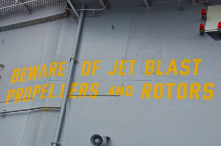 Warning on the flight deck of an aircraft carrier. photo
