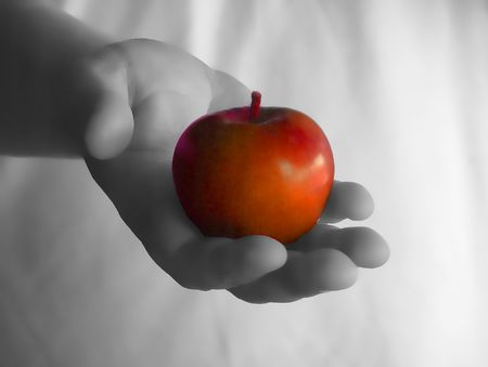 Hand holding a juicy healthy red apple Stock Photo