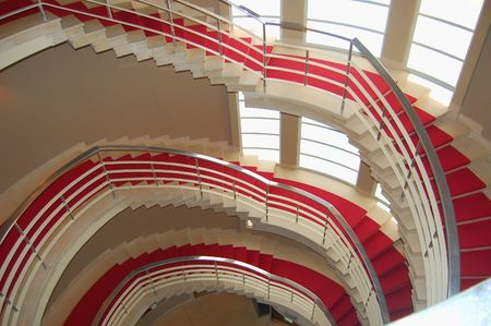 Red carpet on an art decco spiral staircase