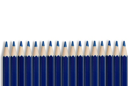 A line of sharpened blue pencil crayons Stock Photo