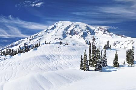 Mount Rainier covered in deep winter snow photo