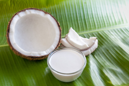 Coconut with milk  on coconut leaf background