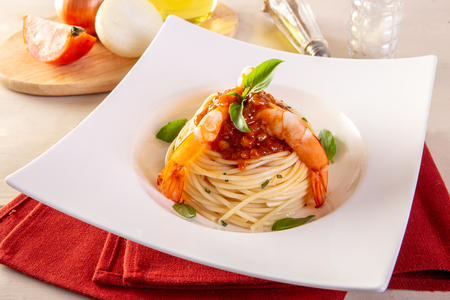 Spaghetti with shrimp and basil on a plate