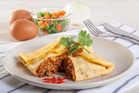 Omelet with vegetable salad and chili