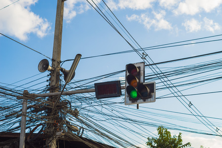 trafficlight: Old traffic light with tangled  electric wire.