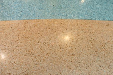 Top view of blue and orange terrazzo floor background.