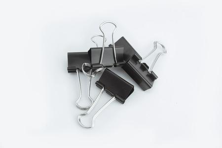 Black Paper clips on white background. Archivio Fotografico