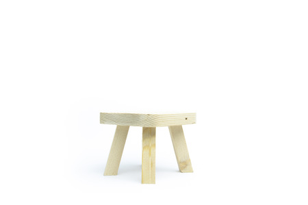 Small table maked from wood with white background. Archivio Fotografico